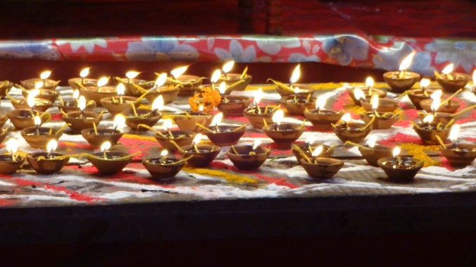 Diya(earthen lamps) lit by devotees for worship to Goddess Durga, the God of Power.@ http://agileopedia.com